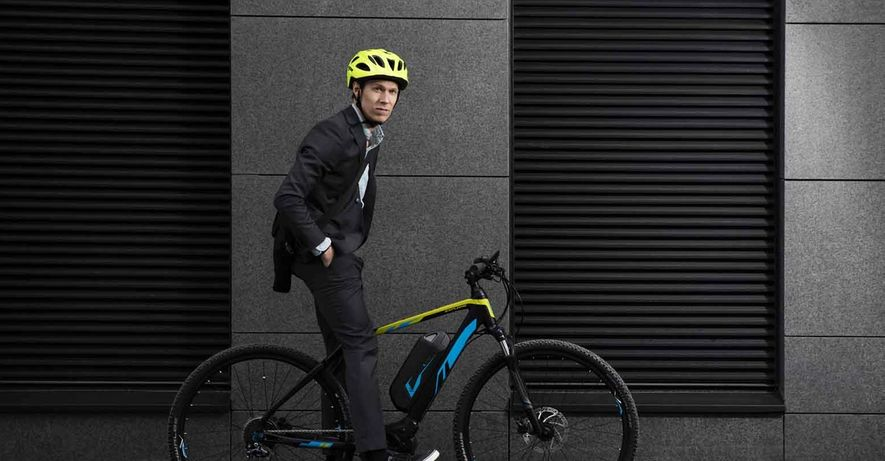 man in suit and e-bike